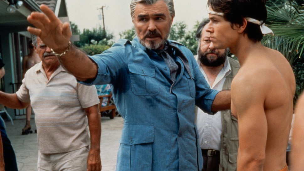 Burt Reynolds' character directing Mark Wahlberg on the set of a filmalr