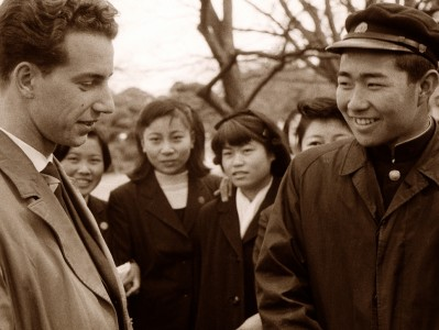 a sepia-toned image of a Japanese man and a white man smiling at each other while Japanese women look on