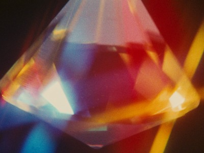 light hitting a crystal and splitting into many colors