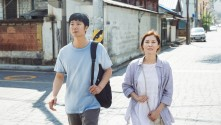 man and woman walking in the street
