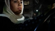 close-up of Iranian woman with veil on driving at night
