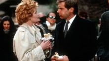 Melanie Griffith and Harrison Ford talking and eating burritos out in the city streets